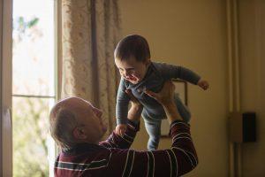 Hospice patient carrying grandchild