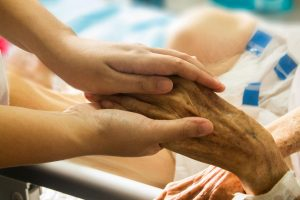 family holding hands at hospice